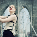 Dancer Hollie Miller playing Human Harp on the Brooklyn Bridge's 130th Birthday