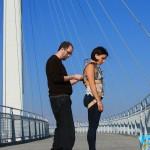 Jason Webb and Di Mainstone testing a harp-harness on Bob Kerrey Suspension bridge, Omaha
