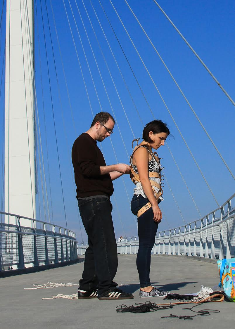 Jason Webb and Di Mainstone testing a harp-harness on Bob Kerrey Suspension bridge, Omaha